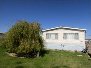 """Photo 1: 10439 100A Street: Taylor Manufactured Home for sale in """"TAYLOR"""" (Fort St. John (Zone 60))  : MLS®# N245044"""