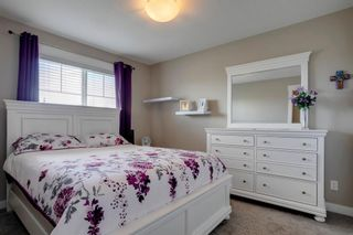 Photo 22: 15 West Coach Manor SW in Calgary: West Springs Row/Townhouse for sale : MLS®# A1100327