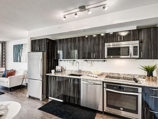 Photo 10: 801 450 8 Avenue SE in Calgary: Downtown East Village Apartment for sale : MLS®# A1071228
