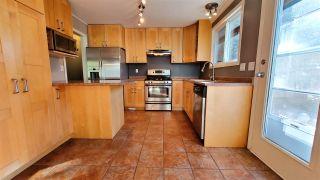Photo 4: 2612 RHUM AND EIGG Drive in Squamish: Garibaldi Highlands House for sale : MLS®# R2507455
