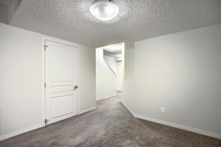 Photo 32: 240 ELGIN MEADOWS Gardens SE in Calgary: McKenzie Towne Semi Detached for sale : MLS®# A1014600