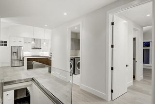 Photo 13: 5911 Lockinvar Road SW in Calgary: Lakeview Detached for sale : MLS®# A1048910