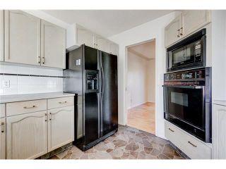 Photo 9: 313 WINDSOR Avenue: Turner Valley House for sale : MLS®# C4099234