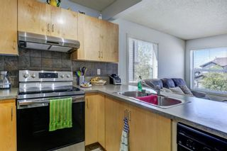 Photo 8: 388 Panatella Boulevard NW in Calgary: Panorama Hills Row/Townhouse for sale : MLS®# A1114400