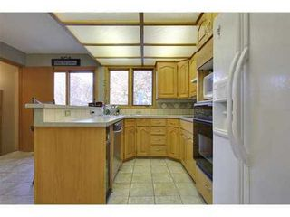 Photo 11: 4 HAULTAIN Place SW in Calgary: Bungalow for sale : MLS®# C3545547