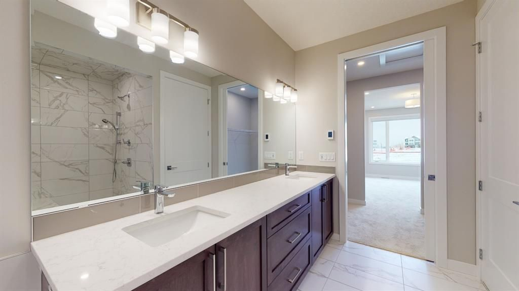 Photo 32: Photos: 38 Crestridge Bay SW in Calgary: Crestmont Row/Townhouse for sale : MLS®# A1073636