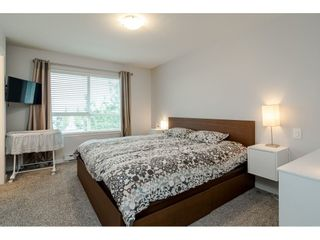 """Photo 16: 10 7088 191 Street in Surrey: Clayton Townhouse for sale in """"Montana"""" (Cloverdale)  : MLS®# R2500322"""