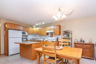 Photo 5: 104 5220 50A Avenue: Sylvan Lake Row/Townhouse for sale : MLS®# A1146974
