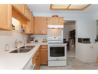 """Photo 10: 102 5375 205 Street in Langley: Langley City Condo for sale in """"GLENMONT PARK"""" : MLS®# R2053882"""