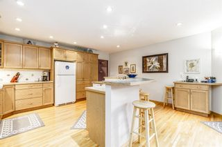 Photo 7: 73 Langton Drive SW in Calgary: North Glenmore Park Detached for sale : MLS®# A1112301