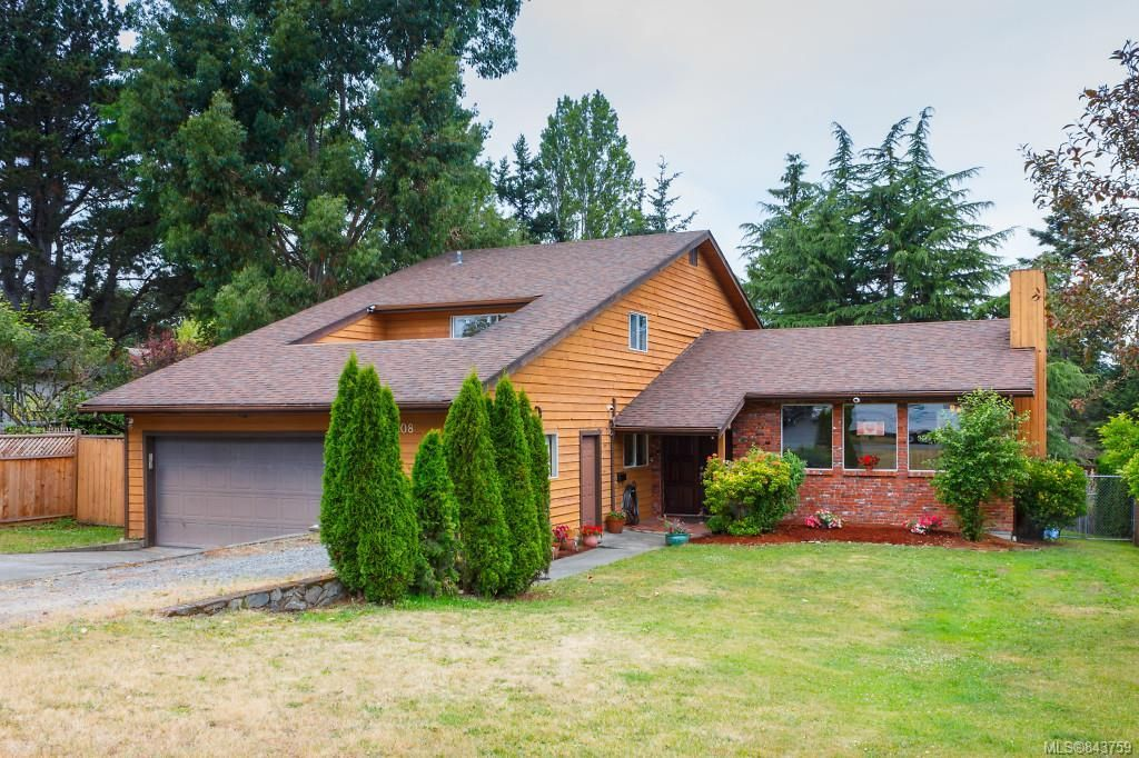 Split level home offers over 2500 sq ft over 3 levels on large private lot.
