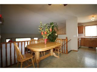 Photo 4: 228 ERIN MEADOW Close SE in Calgary: Erin Woods House for sale : MLS®# C4069091