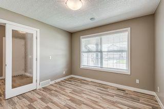 Photo 7: 410 Boulder Creek Way SE: Langdon Detached for sale : MLS®# A1128135