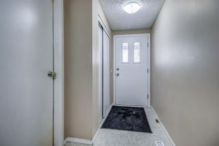 Photo 2: 1309 Ranchlands Road NW in Calgary: Ranchlands Row/Townhouse for sale : MLS®# A1060522