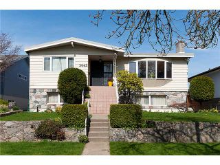 Photo 1: 3043 ROSEMONT Drive in Vancouver: Fraserview VE House for sale (Vancouver East)  : MLS®# V942575