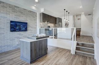 Photo 2: 102 1709 35 Avenue SW in Calgary: Altadore Row/Townhouse for sale : MLS®# A1030241