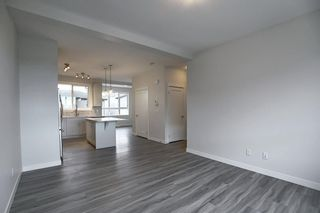 Photo 7: 65 Walgrove Plaza SE in Calgary: Walden Row/Townhouse for sale : MLS®# A1069539