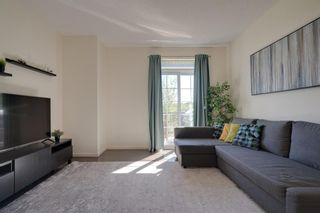 Photo 6: 111 Ascot Point SW in Calgary: Aspen Woods Row/Townhouse for sale : MLS®# A1144877