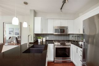 """Photo 8: 106 2161 W 12TH Avenue in Vancouver: Kitsilano Condo for sale in """"The Carlings"""" (Vancouver West)  : MLS®# R2427878"""