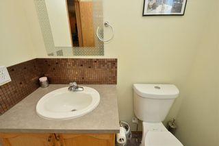 Photo 35: 41 BRIDLERIDGE Gardens SW in Calgary: Bridlewood House for sale : MLS®# C4135340