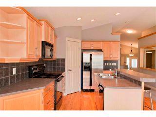 Photo 7: 139 AUBURN BAY Close SE in Calgary: Auburn Bay House for sale : MLS®# C4008235