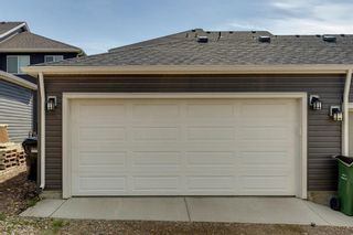 Photo 32: 971 Nolan Hill Boulevard NW in Calgary: Nolan Hill Row/Townhouse for sale : MLS®# A1114155