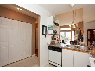 "Photo 10: 311 5955 177B Street in Surrey: Cloverdale BC Condo for sale in ""WINDSOR PLACE"" (Cloverdale)  : MLS®# F1433073"
