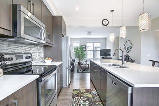 Photo 16: 444 Quarry Way SE in Calgary: Douglasdale/Glen Row/Townhouse for sale : MLS®# A1094767