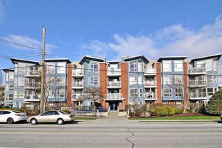 "Photo 1: 401 20245 53 Avenue in Langley: Langley City Condo for sale in ""METRO 1"" : MLS®# R2544690"