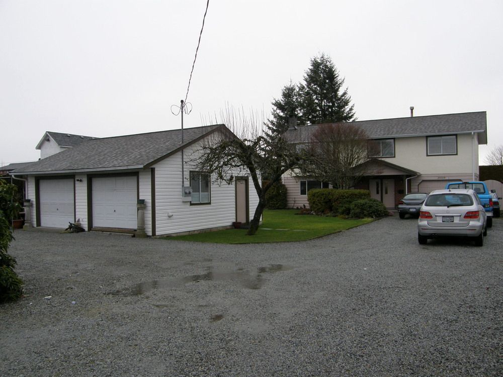 FRONT VIEW SHOWING THE (26 X 25) DETACHED GARAGE AND MAIN HOME
