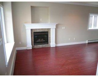 Photo 2: A 917 RODERICK Avenue in Coquitlam: Maillardville 1/2 Duplex for sale : MLS®# V704855