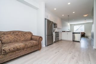 """Photo 17: 100 14555 68 Avenue in Surrey: East Newton Townhouse for sale in """"SYNC"""" : MLS®# R2169561"""