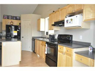 Photo 4: 604 Gib Bell Close: Irricana Residential Detached Single Family for sale : MLS®# C3645673