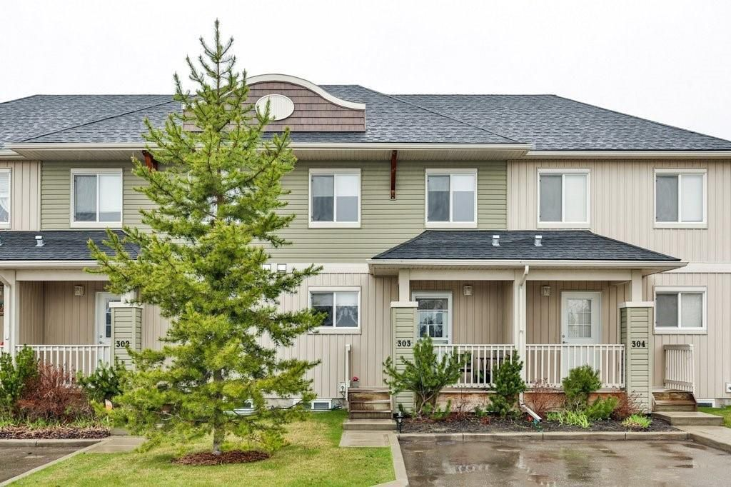 Main Photo: 303 300 Clover Way: Carstairs Row/Townhouse for sale : MLS®# A1145046