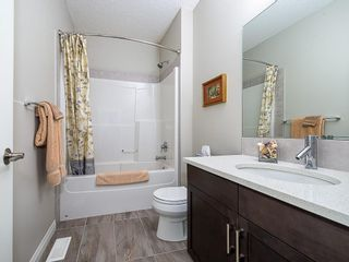 Photo 23: 46 RIVIERA Way: Cochrane Row/Townhouse for sale : MLS®# C4281559