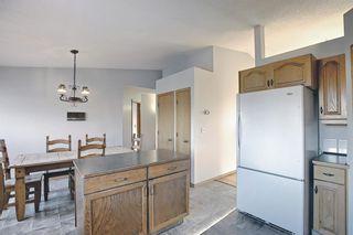 Photo 12: 39 Riverview Close: Cochrane Detached for sale : MLS®# A1079358