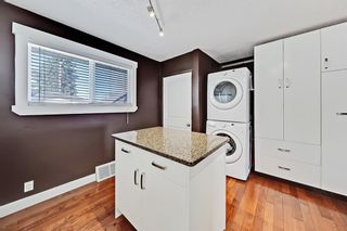 Photo 7: 818 68 Avenue SW in Calgary: Kingsland Detached for sale : MLS®# A1068540