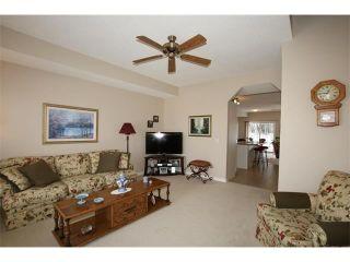 Photo 15: 155 CRAWFORD Drive: Cochrane House for sale : MLS®# C4092224