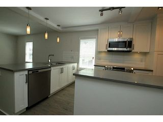 """Photo 6: 101 218 BEGIN Street in Coquitlam: Maillardville House for sale in """"BEGIN SQUARE"""" : MLS®# V1132326"""