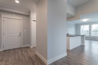 "Photo 7: 504 2229 ATKINS Avenue in Port Coquitlam: Central Pt Coquitlam Condo for sale in ""Downtown Pointe"" : MLS®# R2553513"