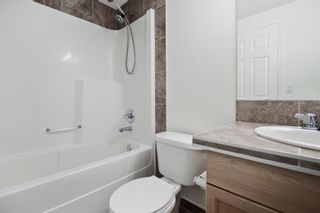 Photo 10: 204 2022 CANYON MEADOWS Drive SE in Calgary: Queensland Apartment for sale : MLS®# A1028195