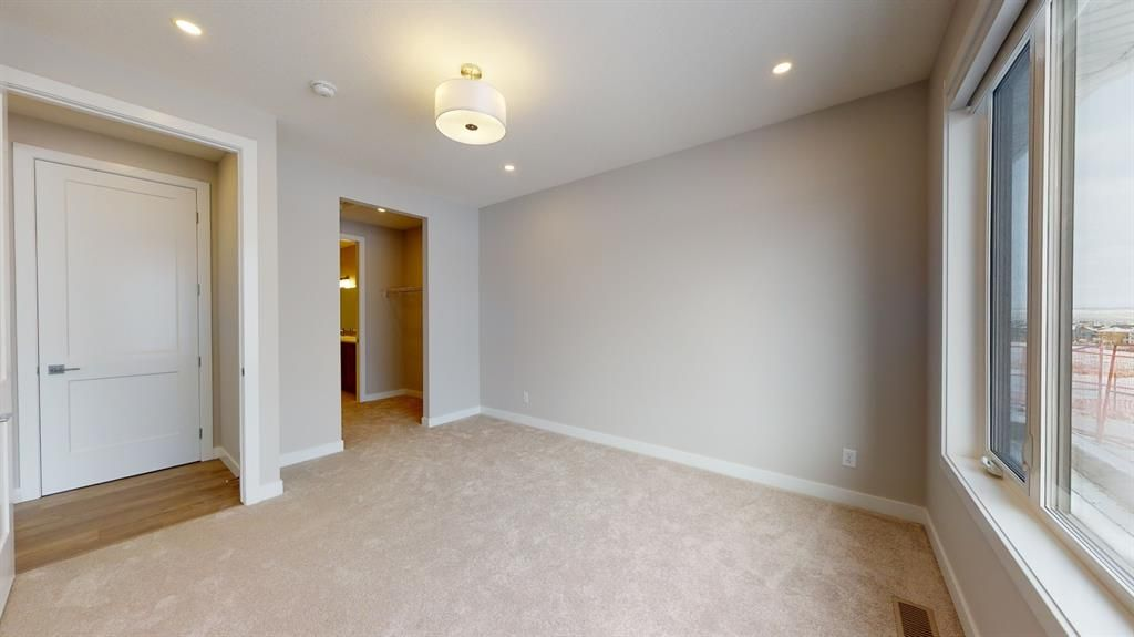 Photo 27: Photos: 38 Crestridge Bay SW in Calgary: Crestmont Row/Townhouse for sale : MLS®# A1073636