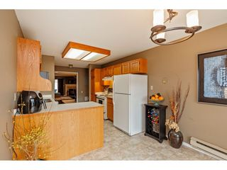 """Photo 7: 103 5641 201 Street in Langley: Langley City Townhouse for sale in """"THE HUNTINGTON"""" : MLS®# R2537246"""