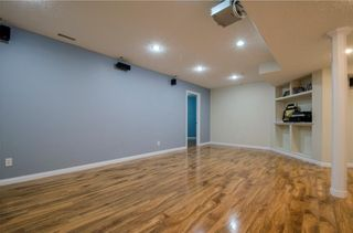 Photo 34: 152 STRATHLEA Place SW in Calgary: Strathcona Park House for sale : MLS®# C4130863