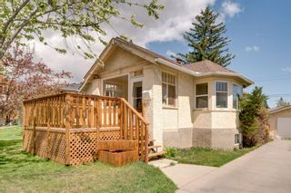 Photo 2: 3118 39 Street SW in Calgary: Glenbrook Detached for sale : MLS®# A1105435