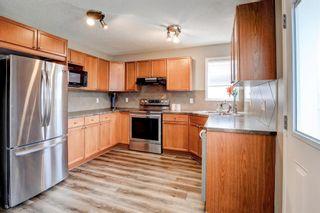 Photo 9: 27 Saddlebrook Place NE in Calgary: Saddle Ridge Semi Detached for sale : MLS®# A1122360