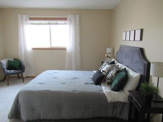 Photo 22: 17 Eversyde Court SW in Calgary: Evergreen Row/Townhouse for sale : MLS®# A1120200