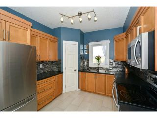 Photo 2: 320 248 SUNTERRA RIDGE Place: Cochrane Condo for sale : MLS®# C4108242