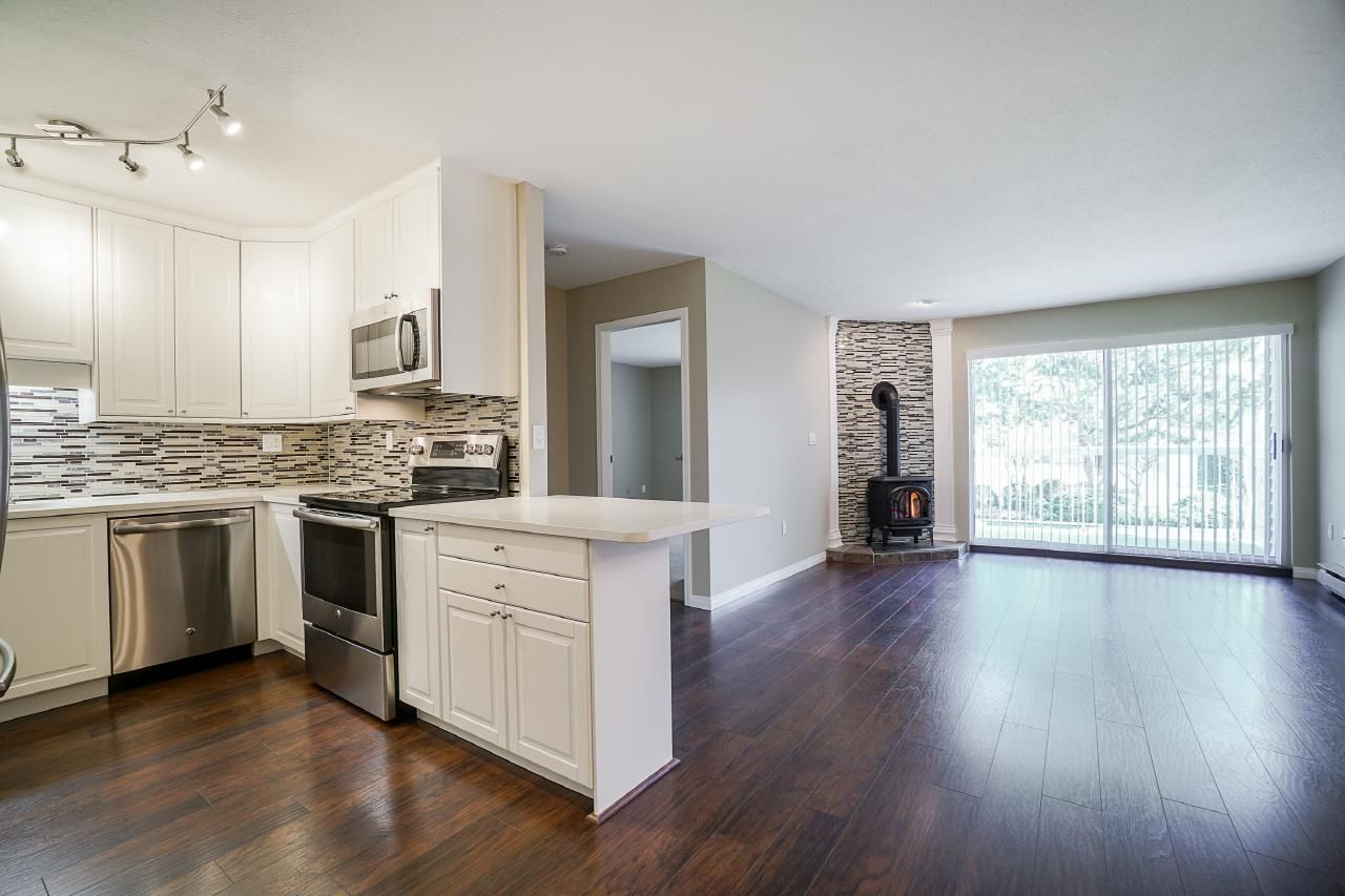 """Main Photo: 102 5379 205 Street in Langley: Langley City Condo for sale in """"Heritage Manor"""" : MLS®# R2447555"""
