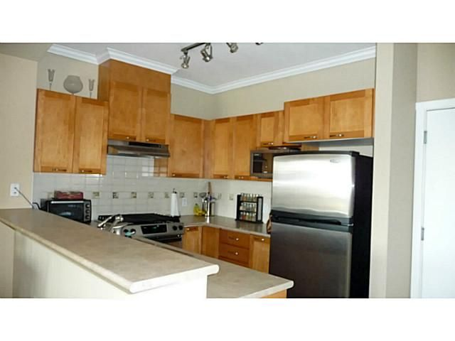 Photo 3: Photos: 109 2969 WHISPER Way in Coquitlam: Westwood Plateau Condo for sale : MLS®# V1001573